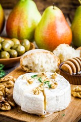 Camembert cheese with walnuts,  honey and thyme