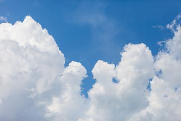 close up of white fluffy cumulus cloud in the blue sky