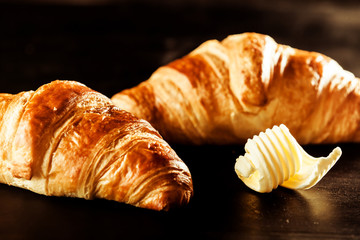 Butter and Croissant Bread on Top of a Table