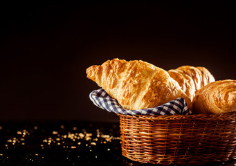 Basket of Fresh Croissant Bread on Top of a Table
