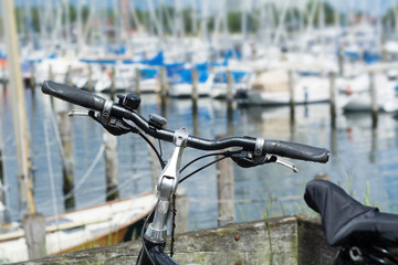 Bicycle in front of the marina with blurred yachts