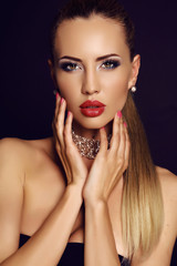 sensual woman with blond hair and bright makeup