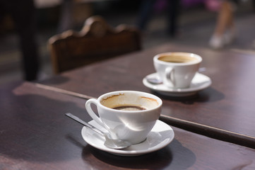 Two cups of coffee on table outside