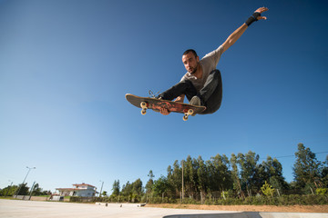Skateboarder flying