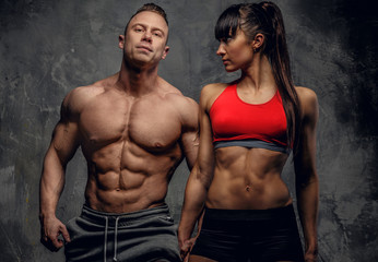 Bodybuilders couple in underwear.