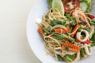 Thai style fried spaghetti with spicy seafood and vegetables