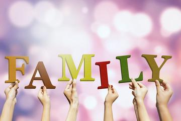 Hands arrange a family text