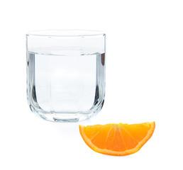 Orange slice and drinking water on white background