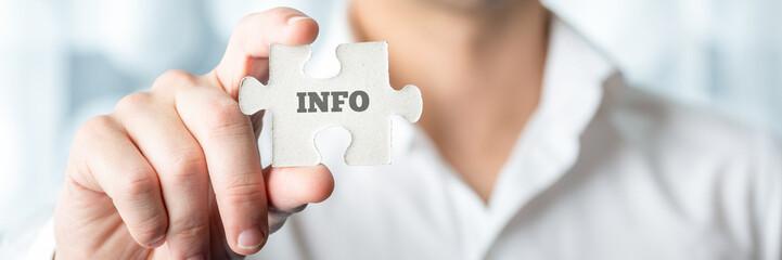 Obraz Businessman Showing Puzzle Piece with Info Text - fototapety do salonu