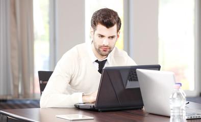 Businessman portrait with laptop