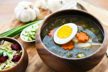green soup with eggs and sorrel in a bowl