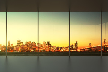 empty office at sunset with view to the skyline