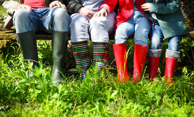 Happy family wearing colorful rain boots