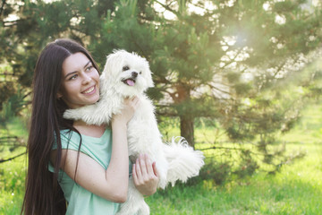 woman beautiful young happy with long dark hair holding small do