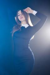 Gorgeous young woman between bright lights