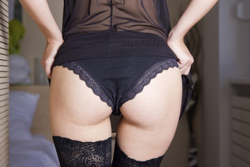 Sexy girl in black panties from behind, body detail