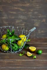 fresh limes in a vintage basket