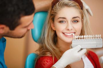 Dentist woman teeth whitening dental clinic