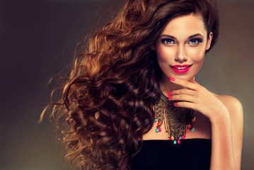 Beautiful model brunette with long curled hair.