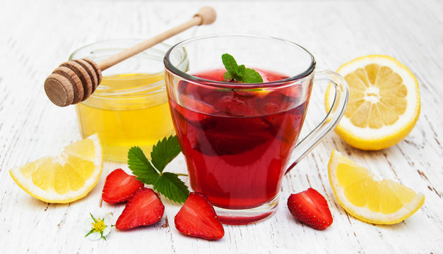 Fruit tea with strawberries and honey
