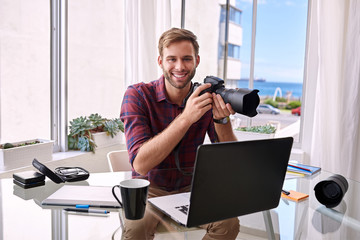 young photographer at his home office