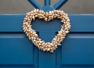 Heart shaped door wreath made from shells