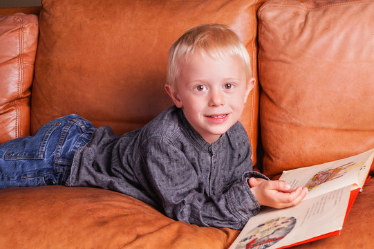 Child reads in one Book