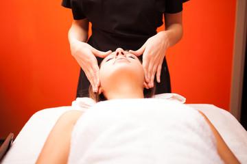 Woman having an head massage