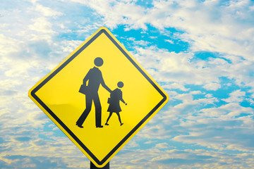 Sign close to school wait for kid cross the road with blue sky