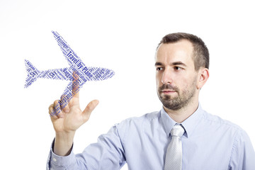 """Young buinessman touching """"Travel by Plane"""" word cloud"""