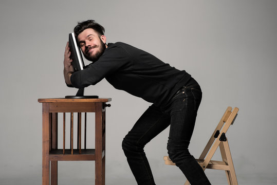 Funny and crazy man using a computer