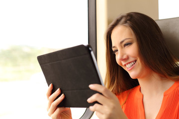 Passenger woman reading a tablet or ebook in a train