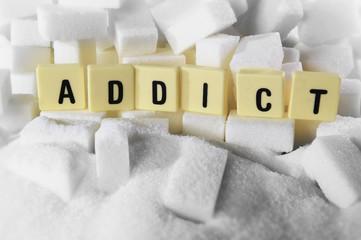 addict block letters word on pile of sugar cubes sugar addiction