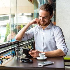 Young Businessman in a Cafe