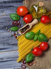 Italian food pasta, tomato, basil, olive oil, pepper