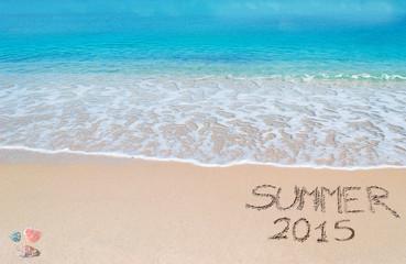 summer 2015 written on a tropical beach