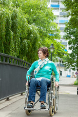 Woman with wheelchair in the park