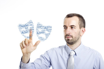 """Young businessman touching """"Theater"""" word cloud"""