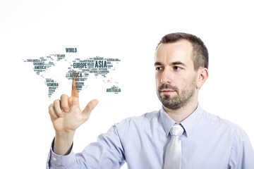 """Young businessman touching """"World"""" word cloud concept"""