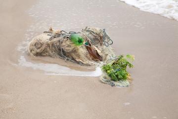 Tangled fishing nets on the beach