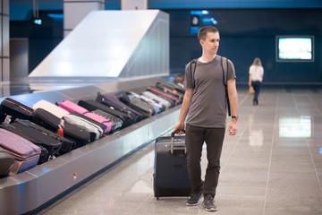 Young man at conveyor belt