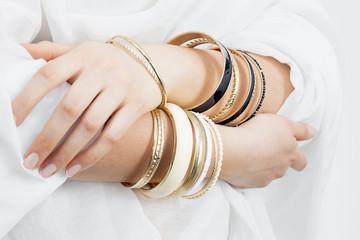 Girl hands with golden bracelets