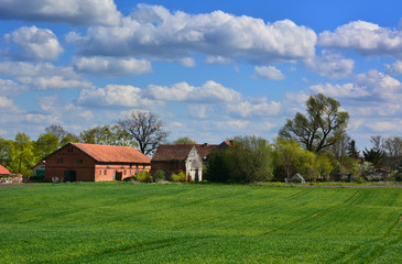 Spring landscape with old farm