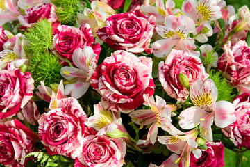 Mixed boquet of red-and-white roses and lilies