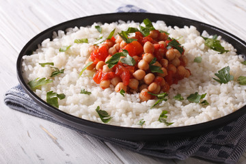 Chickpeas in tomato sauce with rice close-up. Horizontal