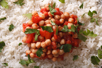 Rice with chickpeas and herbs macro background
