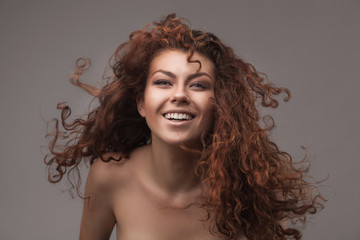 smiling woman with healthy brown curly hair