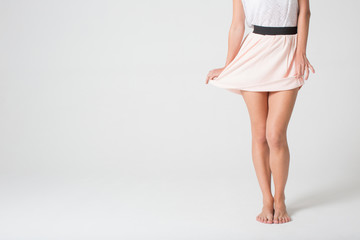 Female legs in a skirt