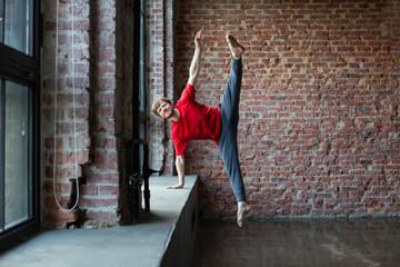 Man dancer jumping up high.