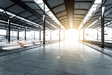 Empty floor of train station platform